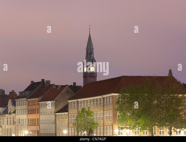 Clock tower overlooking village - Stock Image