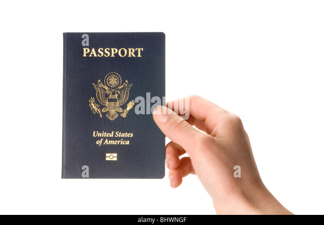 hand holding passport - Stock Image