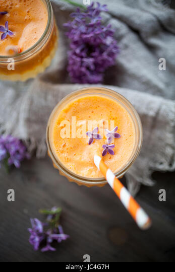 Juice with carrot, apple and orange - Stock Image