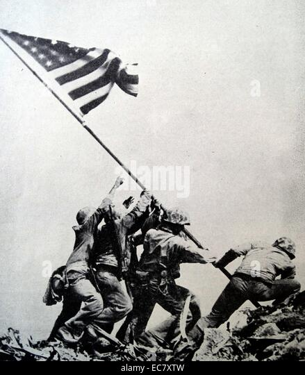 Raising the Flag on Iwo Jima is a historical photograph taken on February 23, 1945. - Stock Image