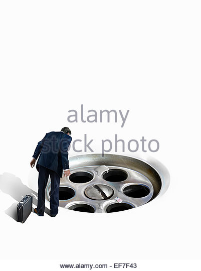 Businessman looking at euro money going down the drain - Stock Image