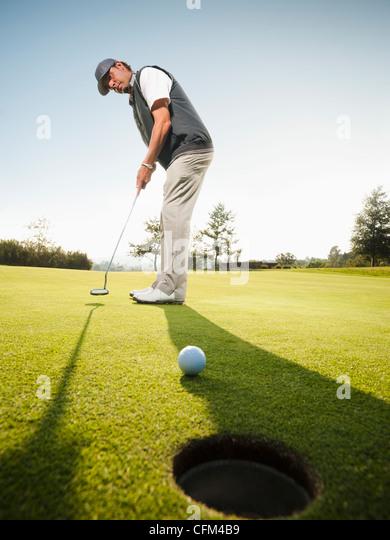 USA, California, Mission Viejo, Man playing golf - Stock Image