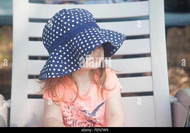Girl Sitting On Deckchair - Stock-Bilder