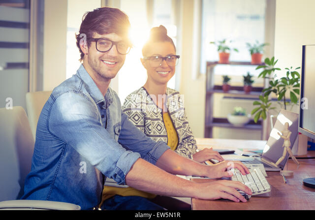 Happy designers working together - Stock Image