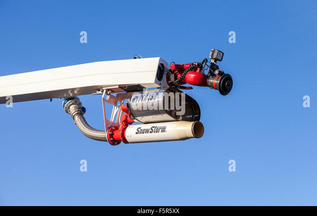Equipment fire extinguishing with foam 'Snowstorm 100 ' over blue sky - Stock Image