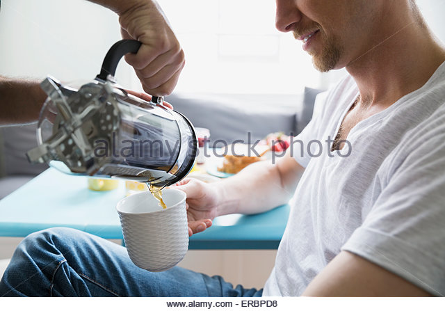 Man pouring French press coffee - Stock-Bilder