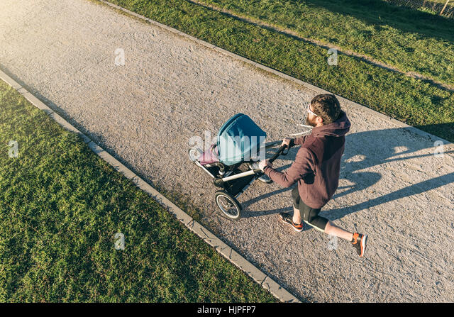 Father and son running in the park. Family and sport concept. - Stock Image