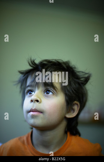 Portrait six year old boy mixed race indian english - Stock Image