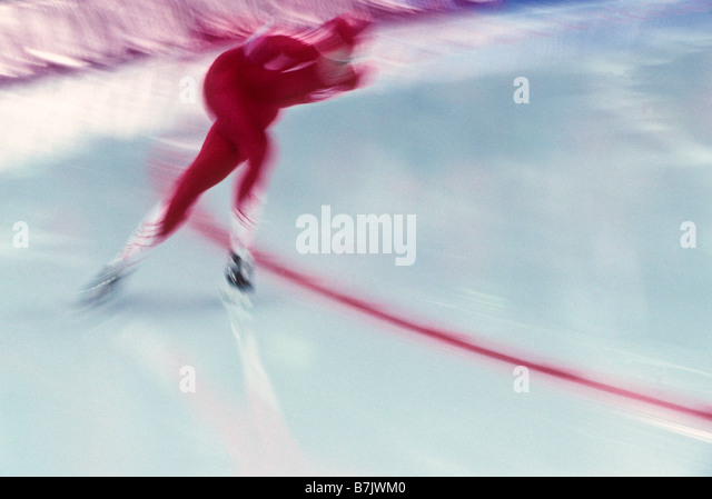 Blurred action of speed skater - Stock Image