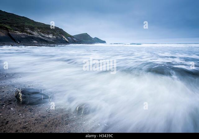 Crackington Haven beach with the headland of Cambeak beyond on the North Cornwall coastline. England. - Stock Image
