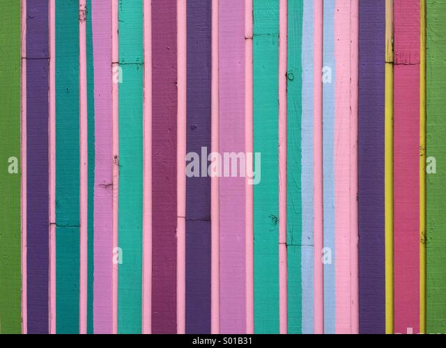 Multi colored pieces of wood on the side of a modern building. - Stock Image