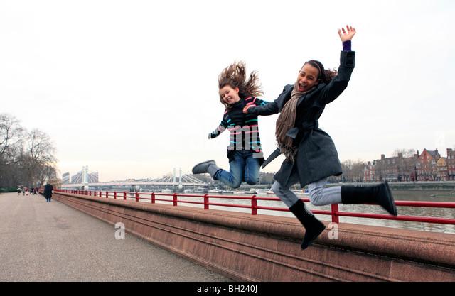 united kingdom london battersea park two teenage girls having fun - Stock-Bilder