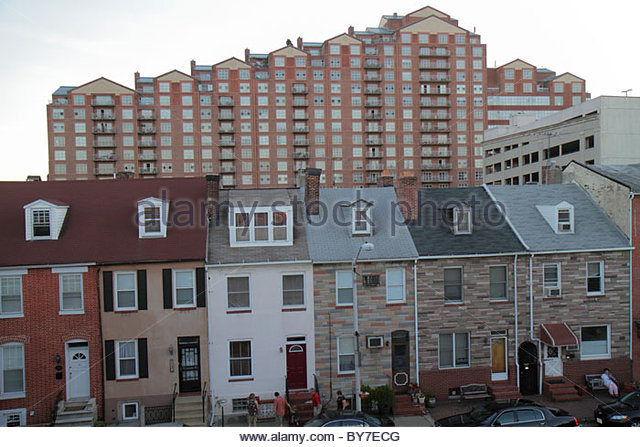 Maryland Baltimore Little Italy ethnic neighborhood row house townhouse working class brick Formstone high rise - Stock Image