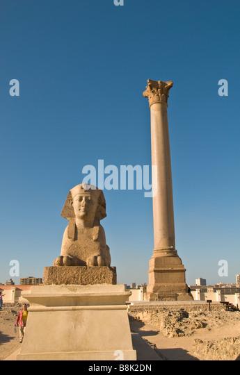 Sphinx Pompeys Pillar Alexandria Egypt historic monument tourist attraction iconic egyptian symbol blue sky - Stock Image