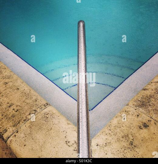 Rain on swimming pool, ruined vacation - Stock-Bilder