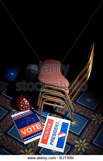 Political rally posters balloons and chairs - Stock Image