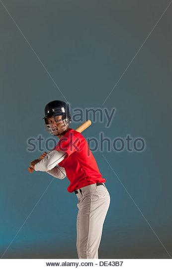Baseball player holding bat - Stock Image