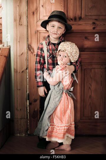 Sweden, Sodermanland, Strangnas, Boy (4-5) and girl (2-3) at home in costumes - Stock-Bilder