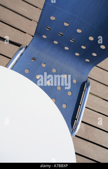 chair and table on deck, high view - Stock Image