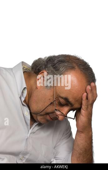 Depressed mature man head in hand - Stock Image