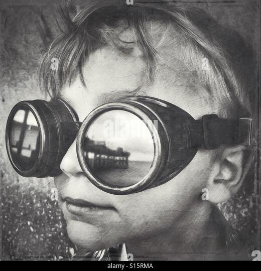 Boy wearing steampunk glasses at the beach - Stock-Bilder