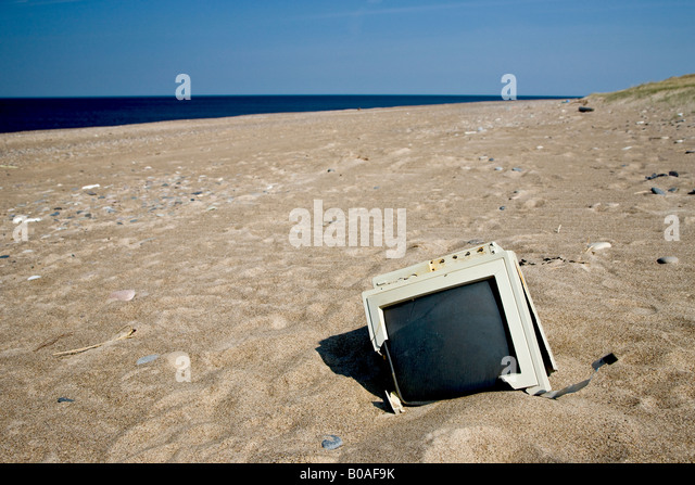 Electronic waste on the beach - Stock Image