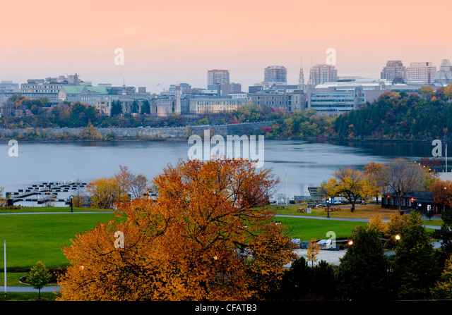 View of Ottawa, Ontario at dusk from Hull, Quebec, Canada. - Stock Image