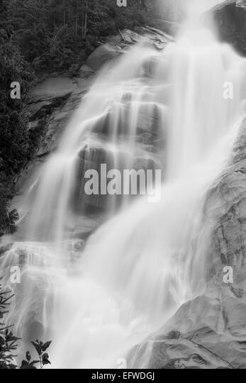 a long waterfall and cliffs, Shannon Falls, Squamish, near Vancouver, British Columbia, Canada (long exposure) - Stock Image