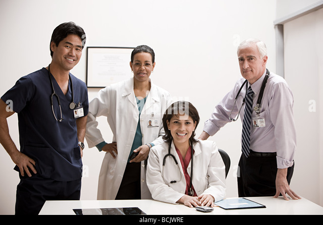 Doctors in office - Stock Image