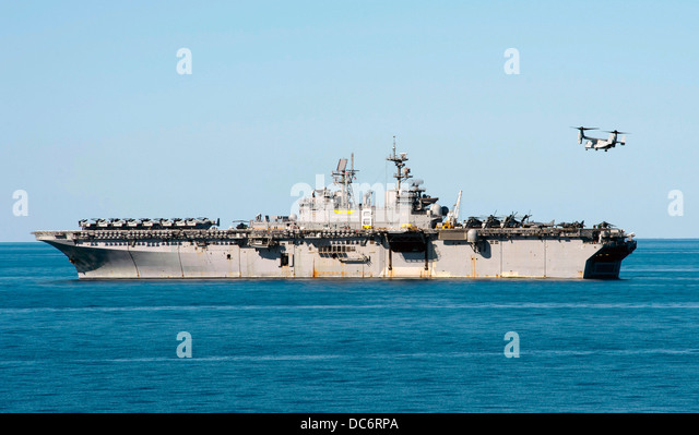 A US Marine MV-22 Osprey approaches amphibious assault ship USS Bonhomme Richard August 6, 2013 operating in the - Stock Image
