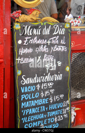 Buenos Aires Argentina Avenida Adolfo Alsina restaurant business chalkboard menu Spanish language typical food prix - Stock Image