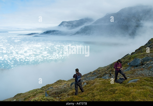 Mist clearing above Sermilik Fjord, East Greenland - Stock Image
