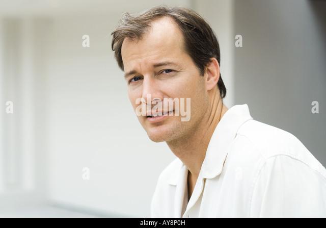 Mature man, looking at camera, portrait - Stock Image