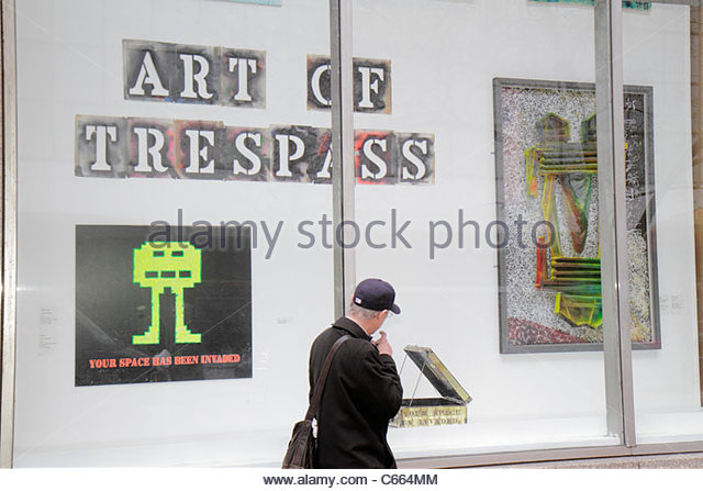 New York New York City NYC Midtown Manhattan 53rd Street Donnell Library window exhibition installation Art of Trespass - Stock Image