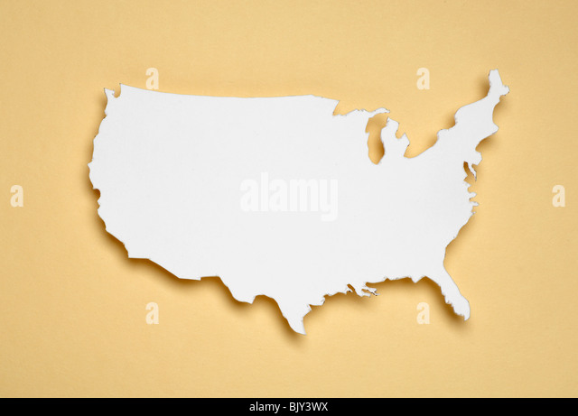 A cut out white paper outline of the United States of America - Stock Image