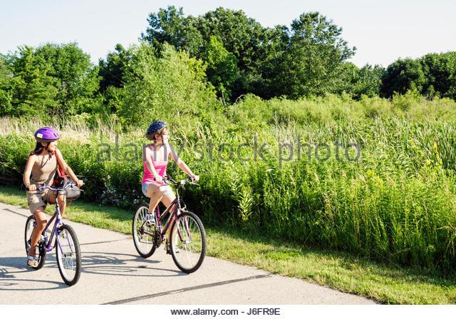 Wisconsin Kenosha Kansasville Richard Bong State Recreation Area Sunrise Campground Asian teen girl bike path bicycle - Stock Image