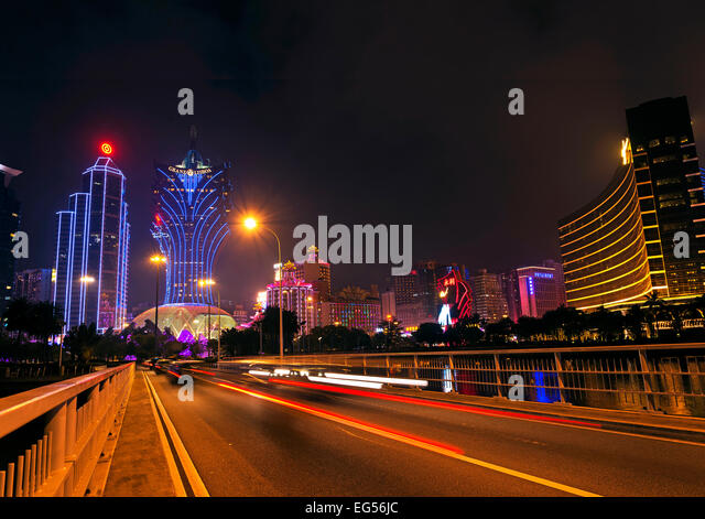 casinos skyline at night in macau china - Stock Image