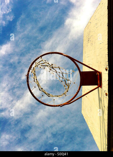 Looking up at a basketball hoop. - Stock Image