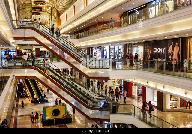 India Asian Mumbai Lower Parel High Street Phoenix mall inside interior Palladium shopping escalators DKNY - Stock Image