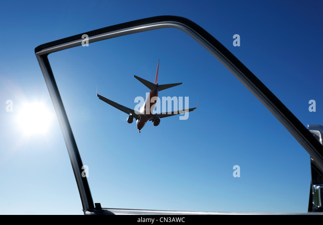 Car door with view of airplane - Stock Image