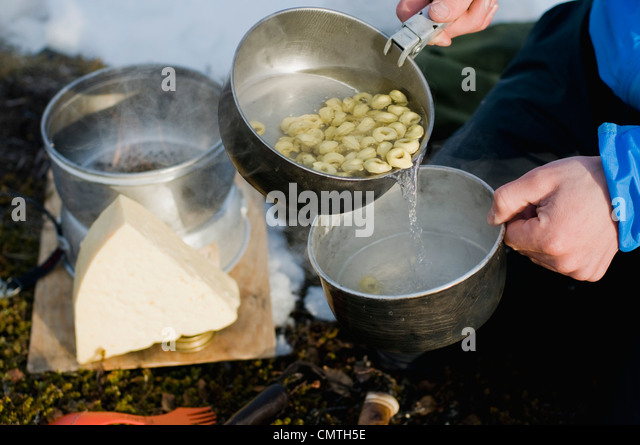 Pouring pasta water - Stock Image