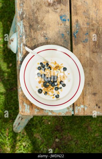 Breakfast_granola with blueberries - Stock Image