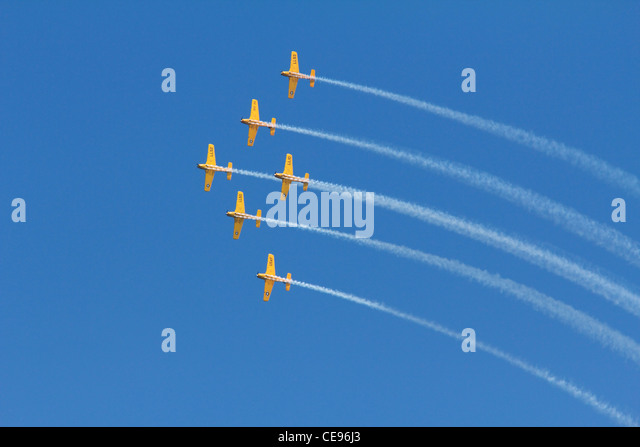 Beech T34 Mentors of the Lima Lima Precision Flight Team in formation. - Stock Image
