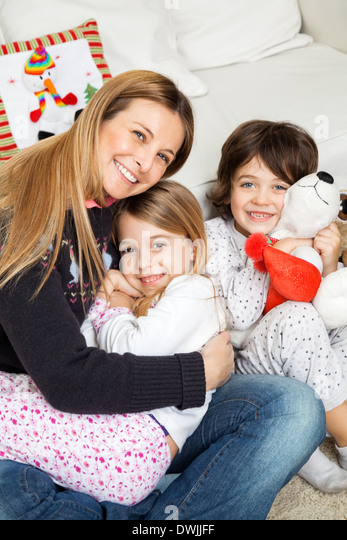 Loving Mother With Children During Christmas - Stock Image
