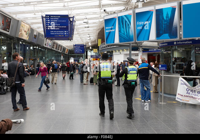 british transport police patrolling Manchester piccadilly railway station England UK - Stock Image
