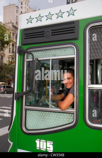 Buenos Aires Argentina Avenida 9 de Julio street scene bus public transportation mass transit Hispanic man driver - Stock Image