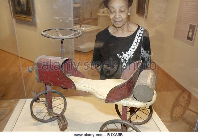 Arkansas Little Rock Historic Arkansas Museum Pedal Car 1900 1920 children's toy Black woman tricycle display - Stock Image