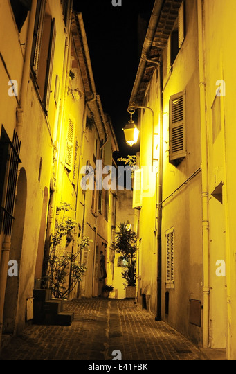 View of an Old Town street of Cannes at night. France - Stock-Bilder