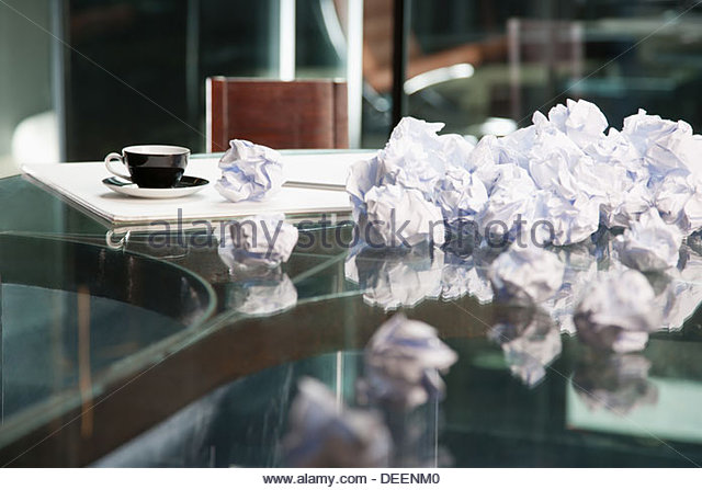Crumpled papers on a table - Stock Image