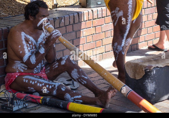 Sydney Australia NSW New South Wales Circular Quay aborigine aboriginal playing didgeridoo body paint - Stock Image